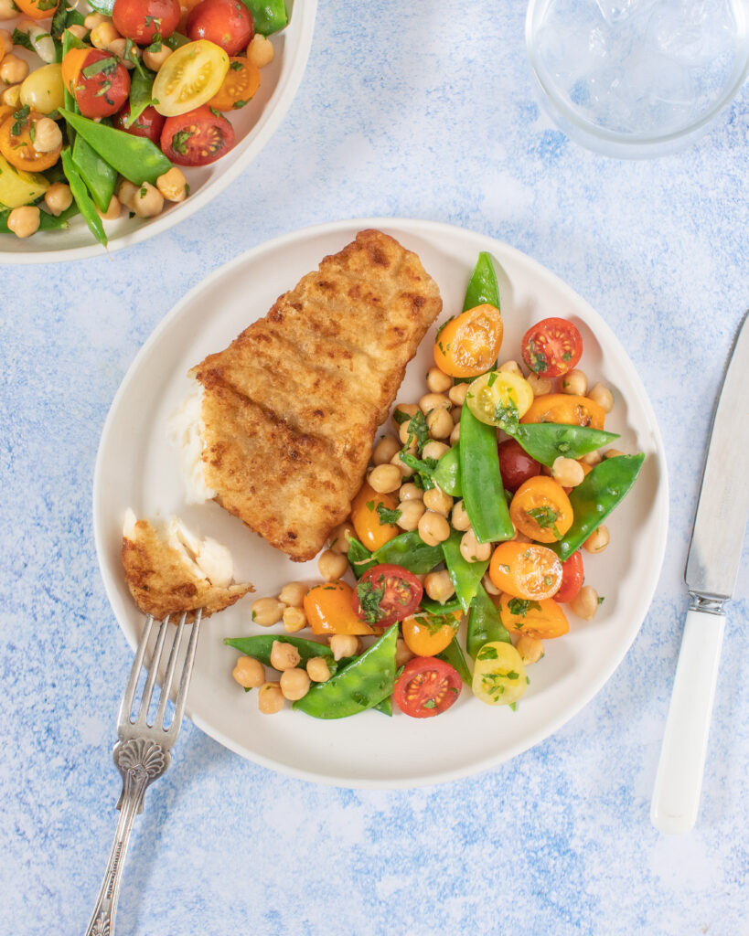 Donegal Catch Cider Cod with chickpea, tomato and sugar snap salad
