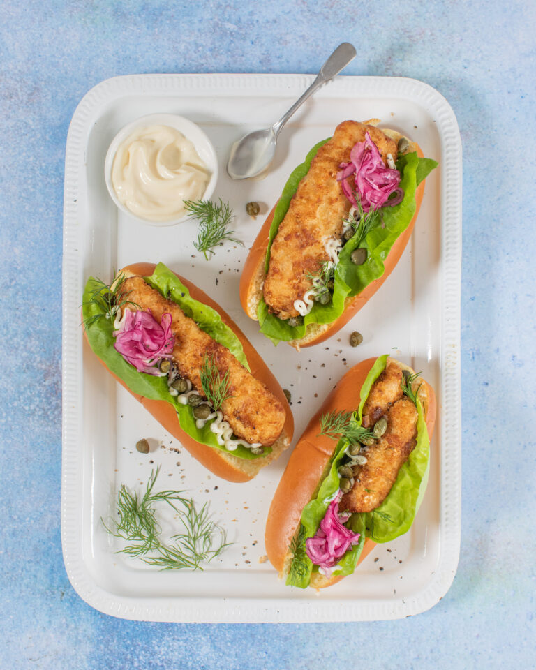 Donegal Catch Cider Haddock 'Fish' dogs with pickled red onions, lettuce and mayonnaise